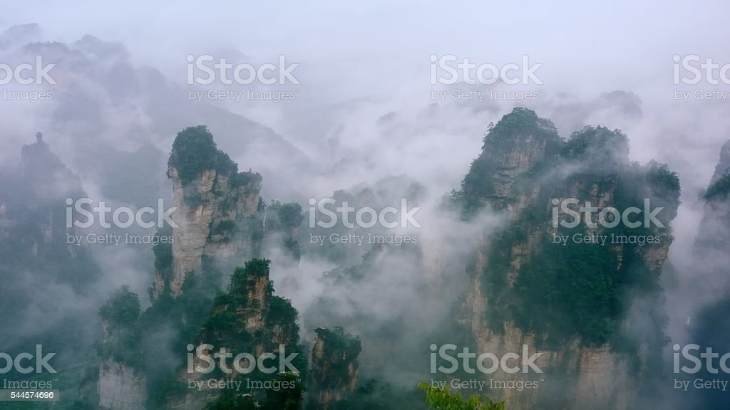 Majestic mountain peaks in the sea of clouds 08 stock photo