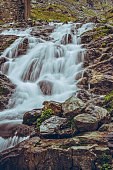 Majestic mountain stream waterfall