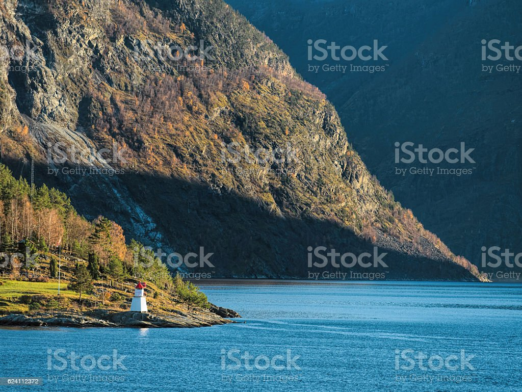 Majestic sognefjord with lighthouse in sunlight, Norway stock photo