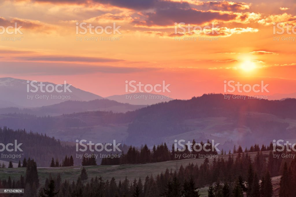 Majestic spring sunset in the mountains landscape stock photo