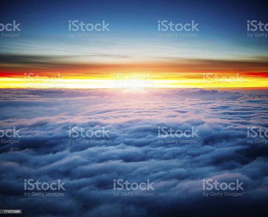 majestic sunrise above clouds stock photo