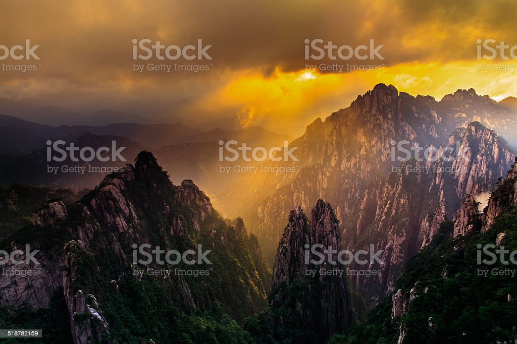 majestic sunset over the mountains stock photo