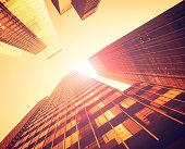 Majestic tall Manhattan skyscraper against Sun