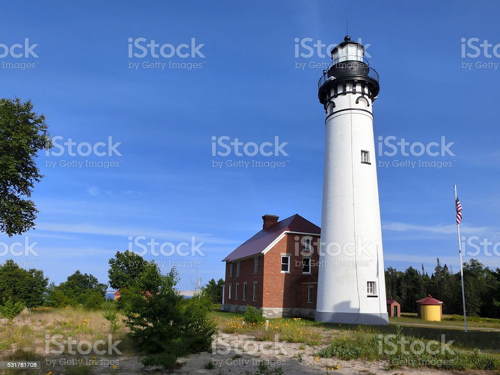 Majestic tall white Au Sable lighthouse in Michigan's upper peninsula stock photo