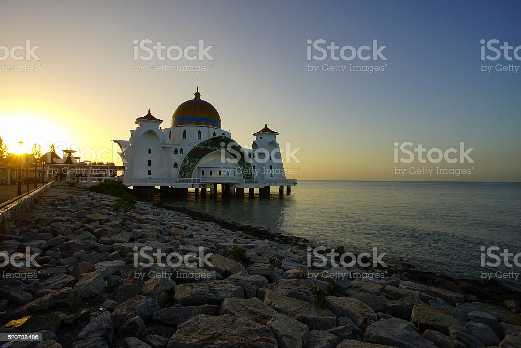 Majestic view of Malacca Straits Mosque during sunset stock photo