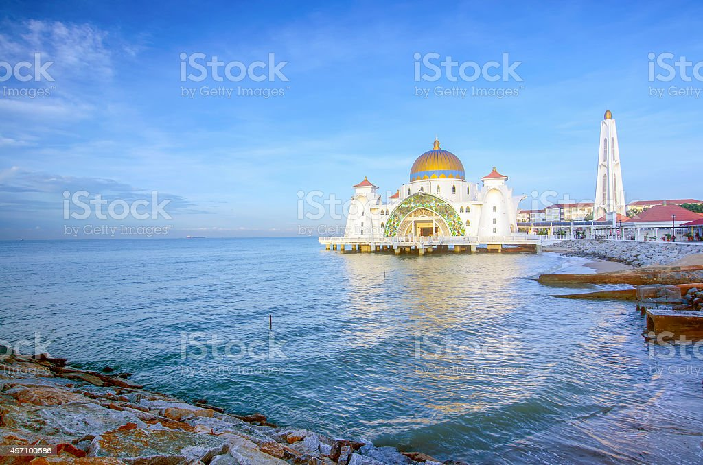 Majestic view of Malacca Straits Mosque with blue sky stock photo
