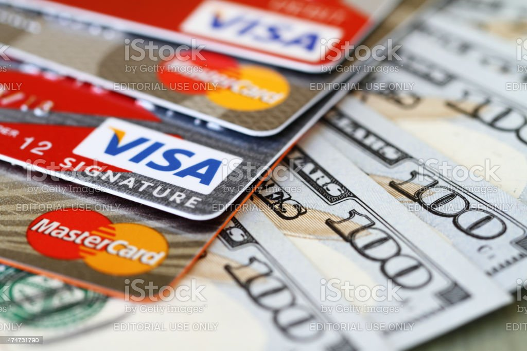 Major credit cards: Visa, MasterCard with 100 dollar bills stock photo