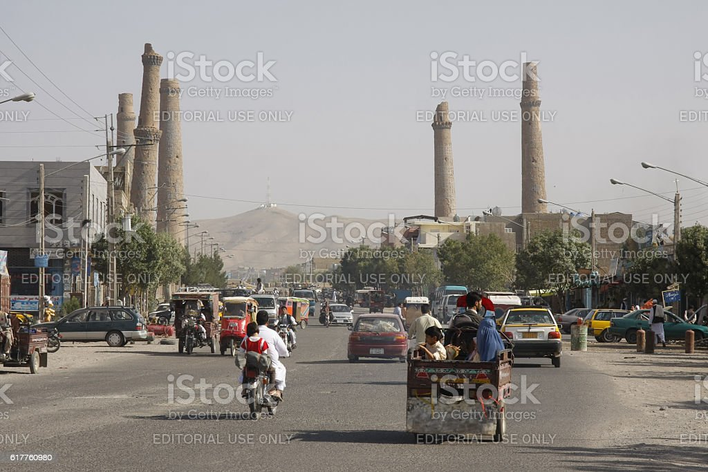 Major street in Herat with minarets in the background stock photo