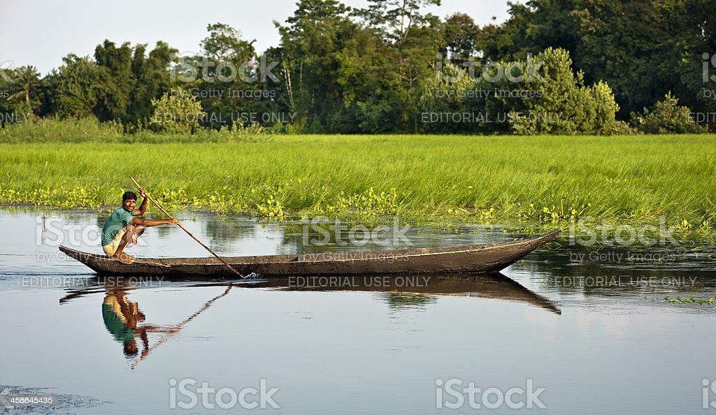 Majuli, man rowing wooden boat, lagoon, Assam, India stock photo
