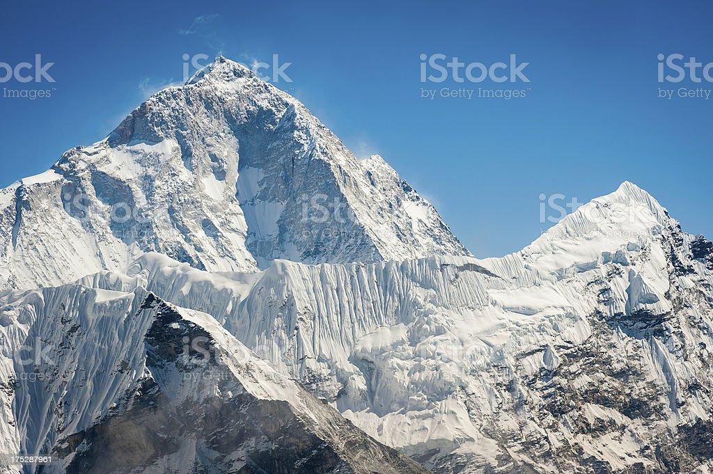 Makalu 8481m snowy summit above dramatic ridge Himalaya mountains Nepal royalty-free stock photo
