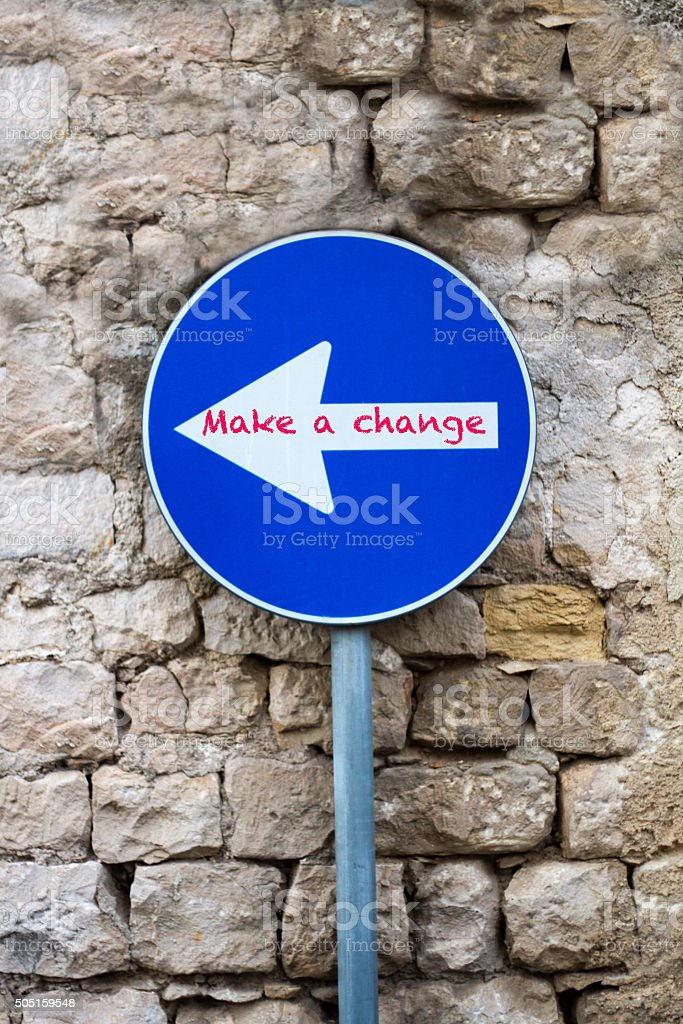 Make a Change: Blue Sign with Arrow Pointing New Direction stock photo