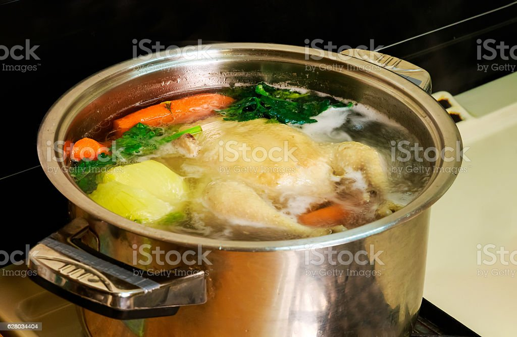 I make chicken broth in a pot, stock photo
