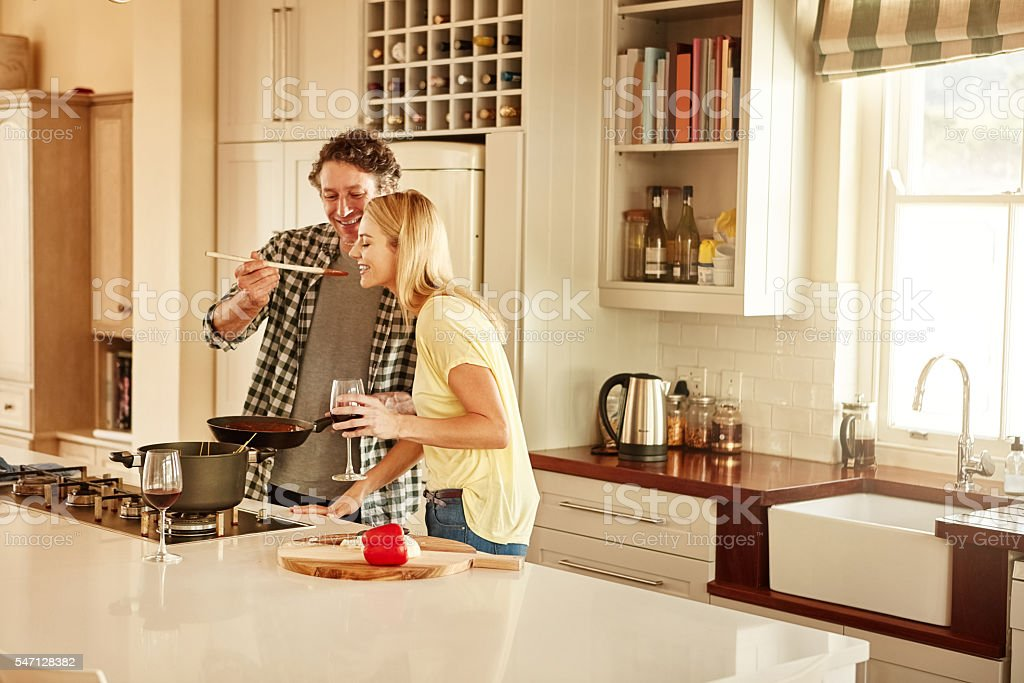Make cooking with your significant other a fun, flirty adventure stock photo