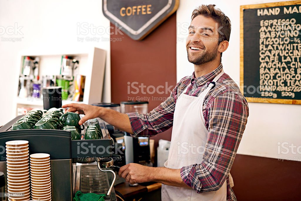 I make every cup with a smile stock photo