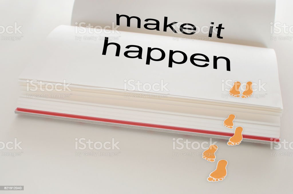Make it happen word with footstep stock photo