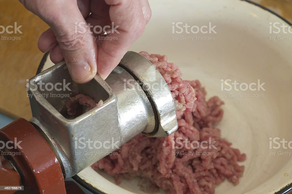 make minced meat using grinder royalty-free stock photo