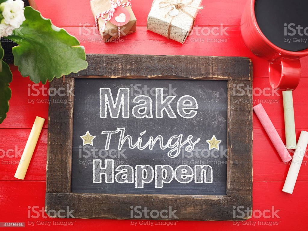 Make Things Happen on sketched in chalk stock photo