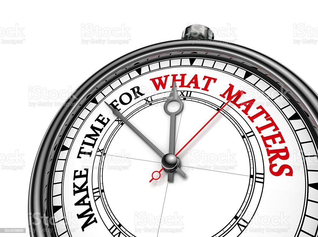 Make time for what matters motivation quote on concept clock stock photo