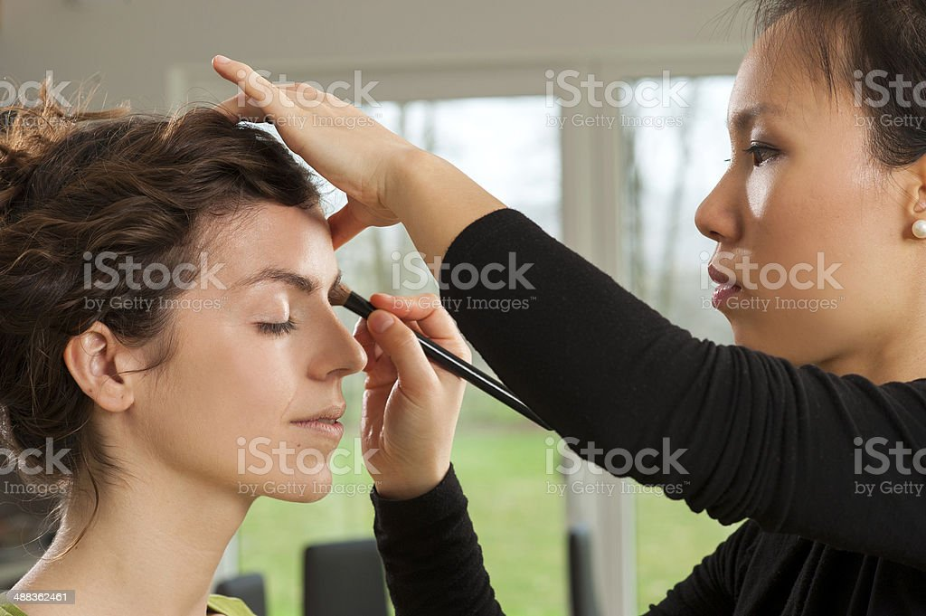 Make up artist and her model stock photo