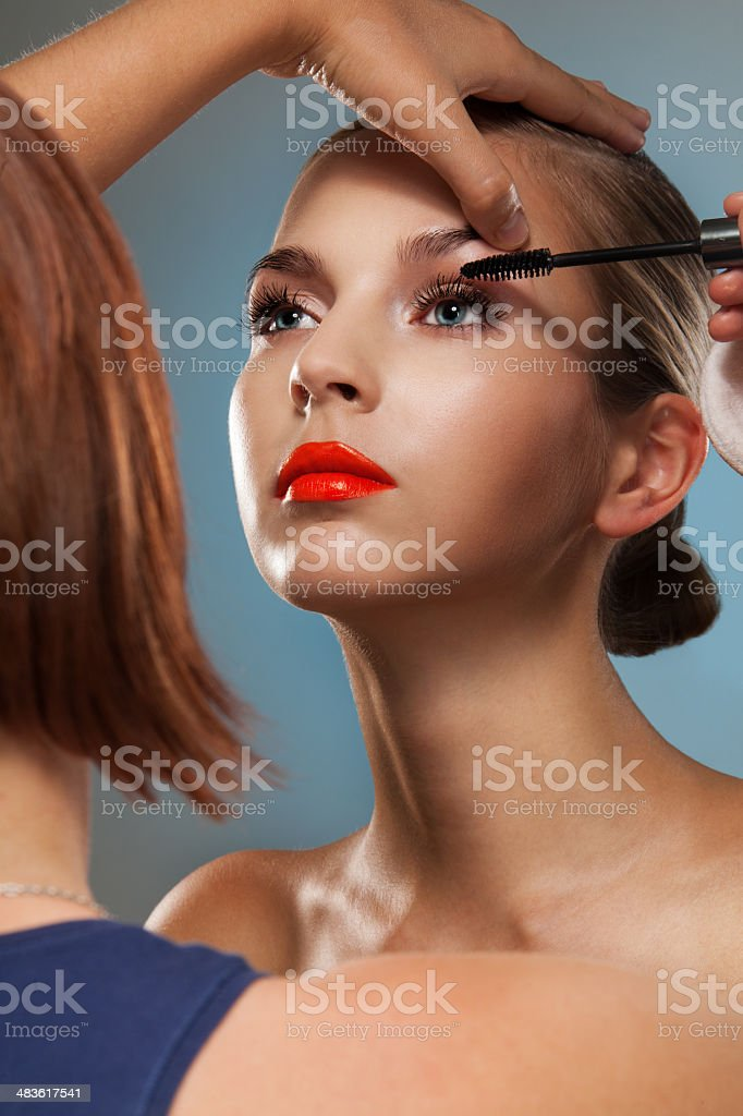 Make up artist at work stock photo