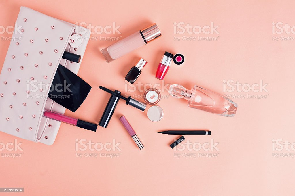 Make up bag with cosmetics isolated on pink background stock photo