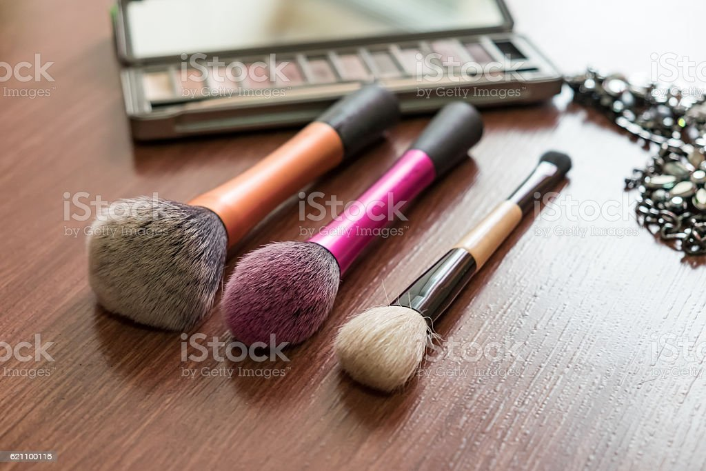 Make up brush product beauty on wood stock photo