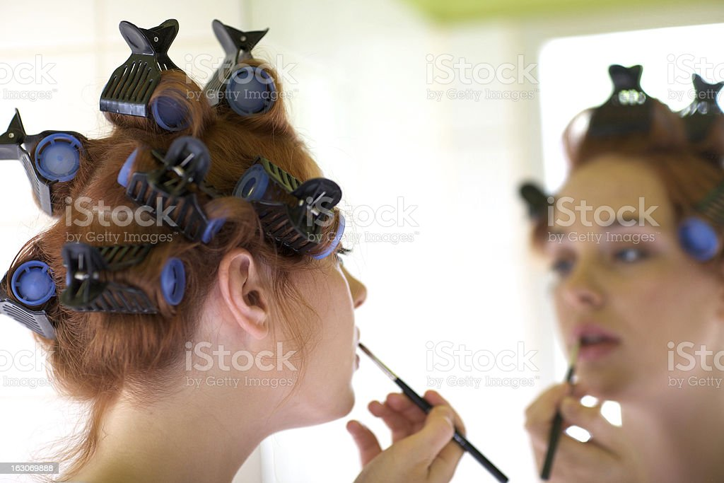 Make up in front of the mirror royalty-free stock photo