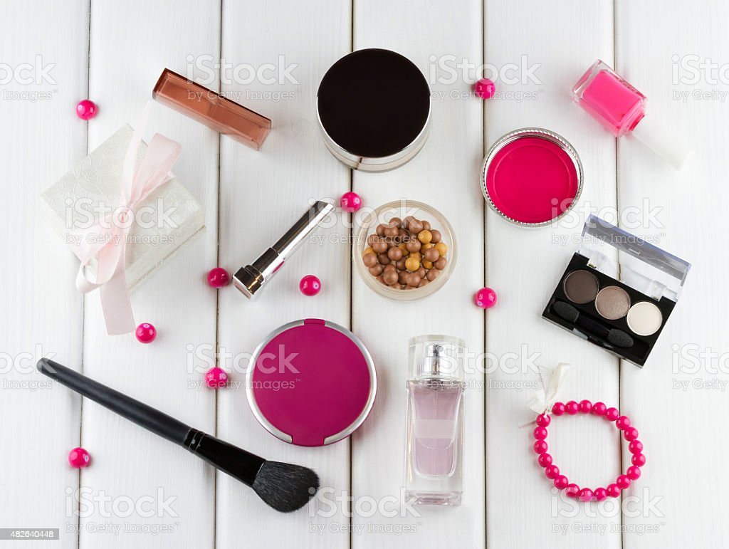 Makeup and cosmetic pink set on white wooden background stock photo