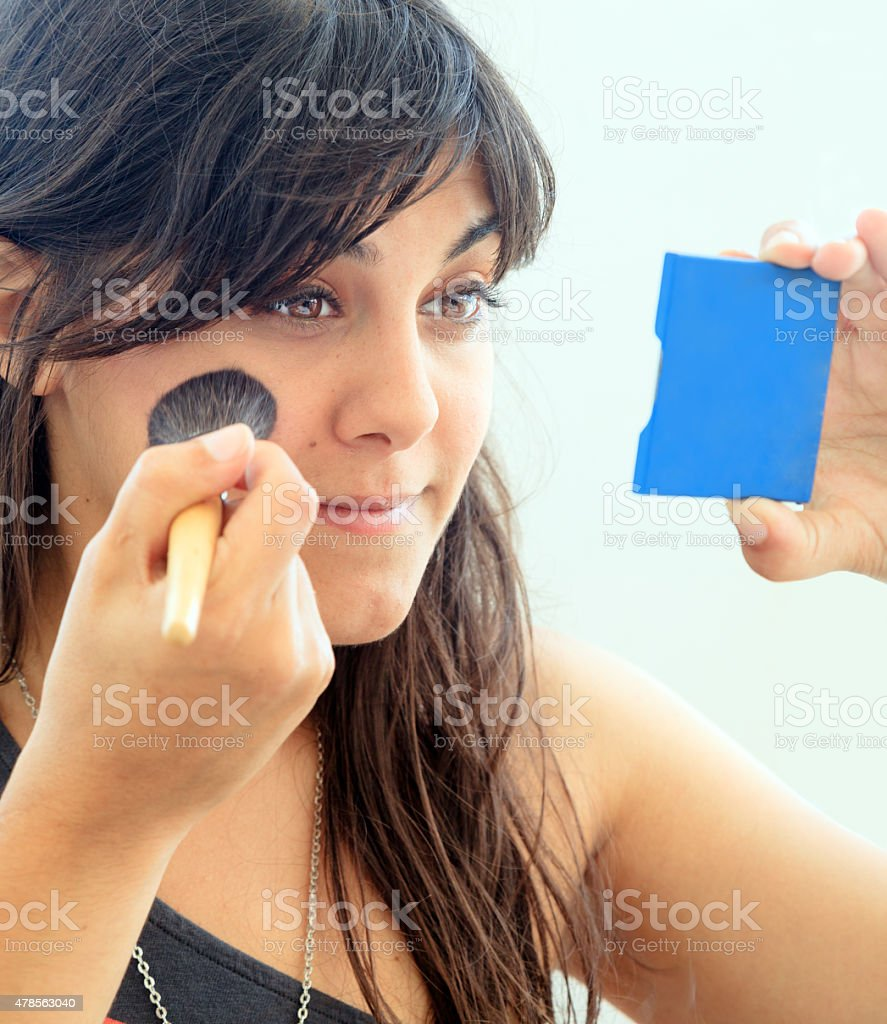 Make-up applying blusher stock photo
