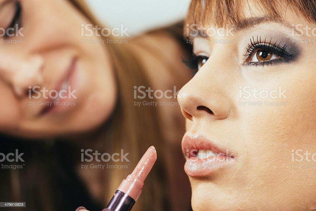 Make-up artist applaying lipstick stock photo