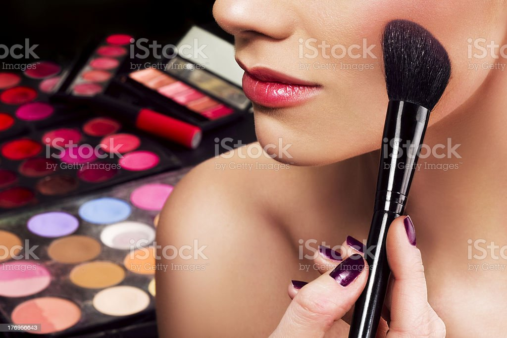 Makeup artist applying blusher stock photo