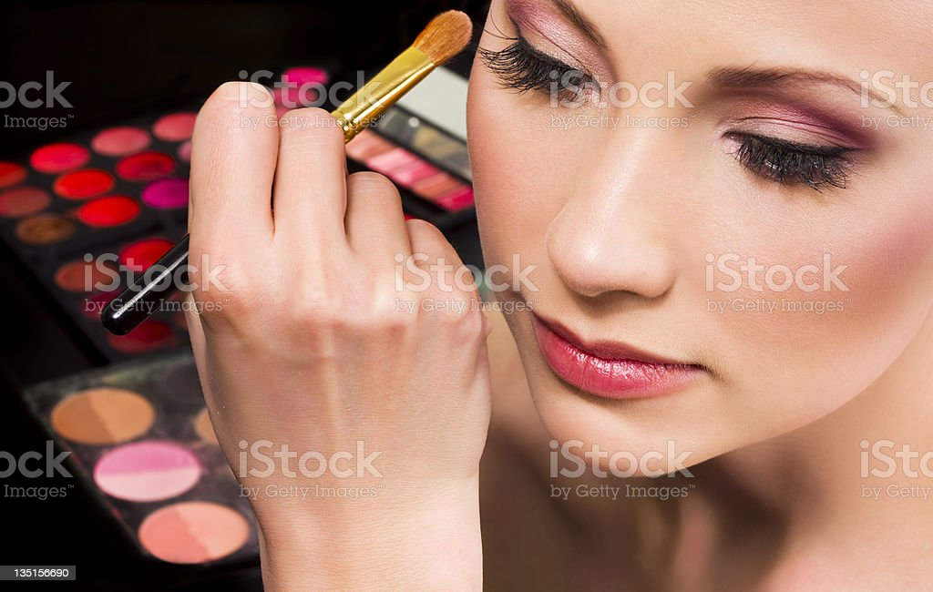 Makeup artist applying eyeshadow royalty-free stock photo