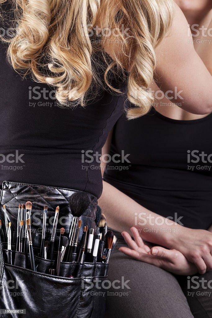 Makeup artist applying make-up stock photo