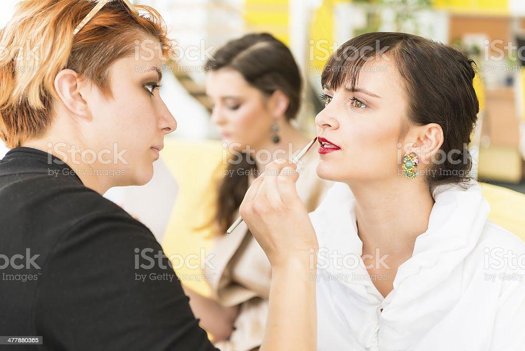 Makeup artist applying make-up royalty-free stock photo