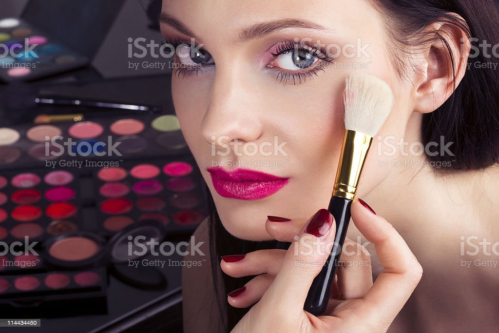 Makeup artist applying shimmer royalty-free stock photo