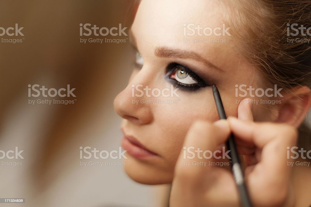 Make-up artist at work. stock photo