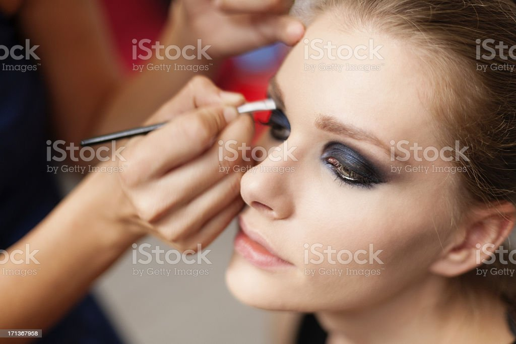 Make-up artist at work. stock photo