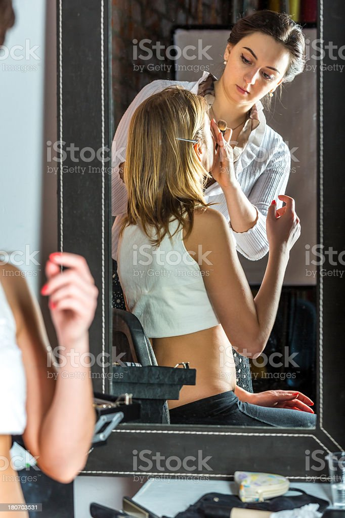 Makeup artist at work royalty-free stock photo