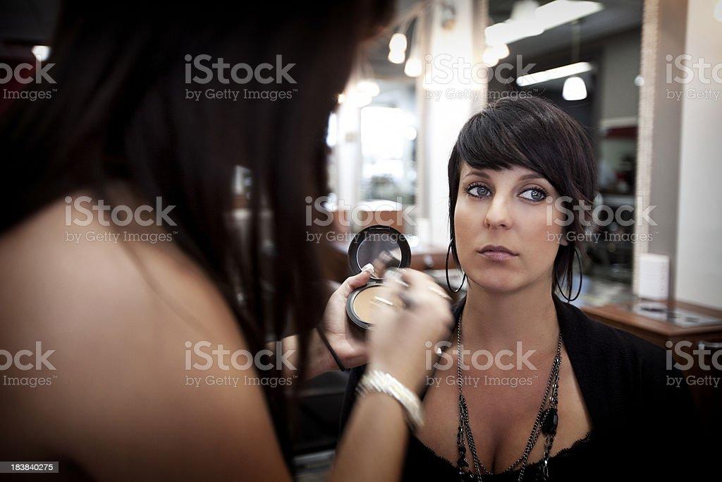 Make-up artist at work royalty-free stock photo