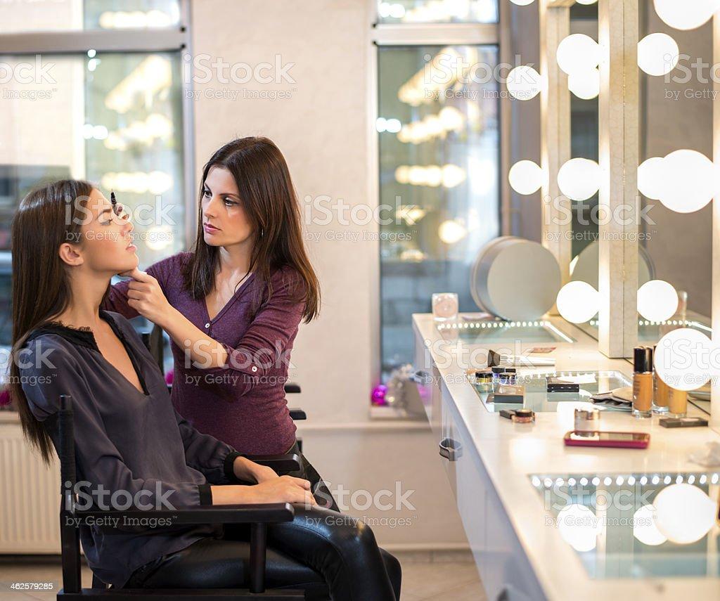 Makeup Artist at work stock photo