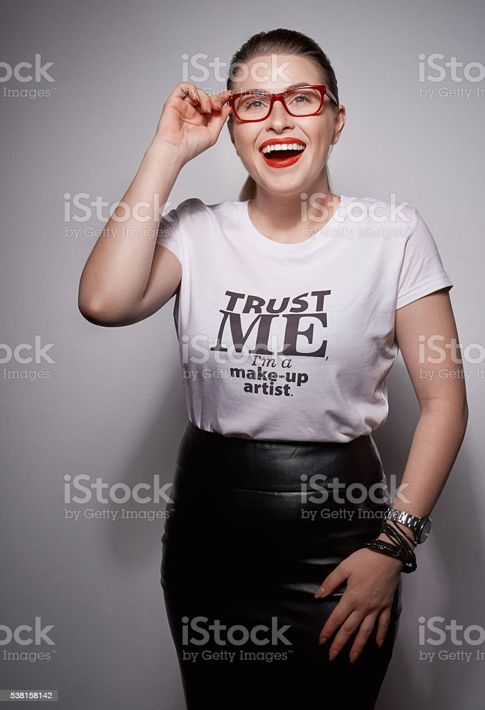 make-up artist in studio shot stock photo