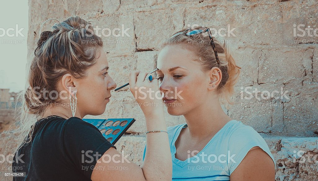 Makeup Artist Preparing Model for a Photoshoot stock photo