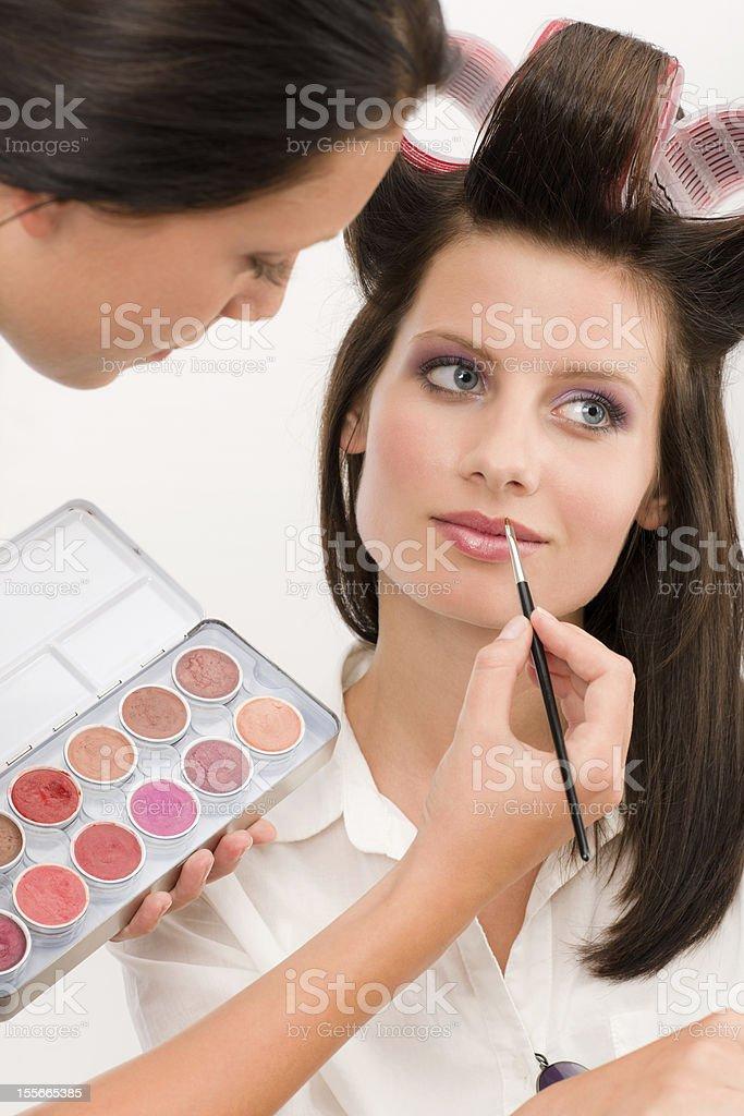 Make-up artist woman fashion model apply lipstick royalty-free stock photo