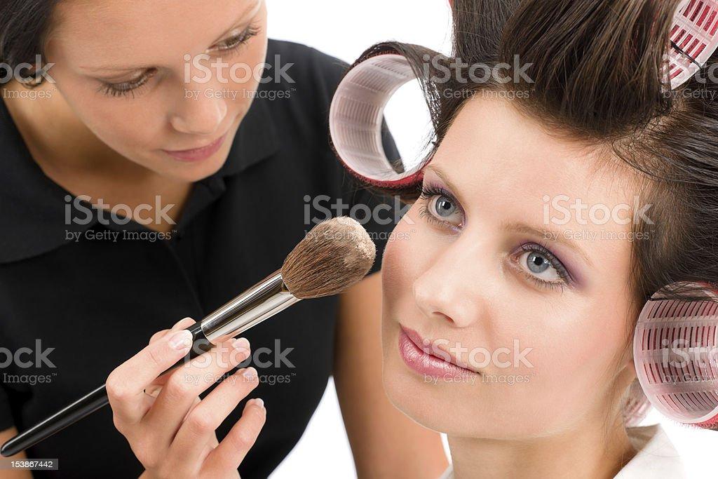 Make-up artist woman fashion model apply powder royalty-free stock photo