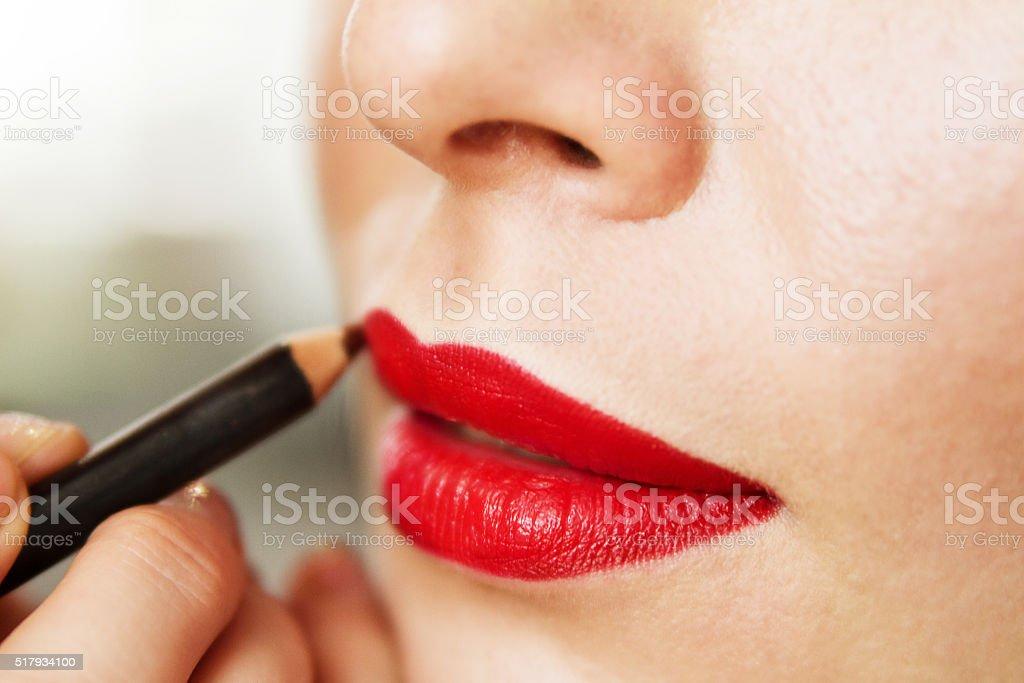 makeup artist work. lip makeup. red lipstick and lip liner stock photo