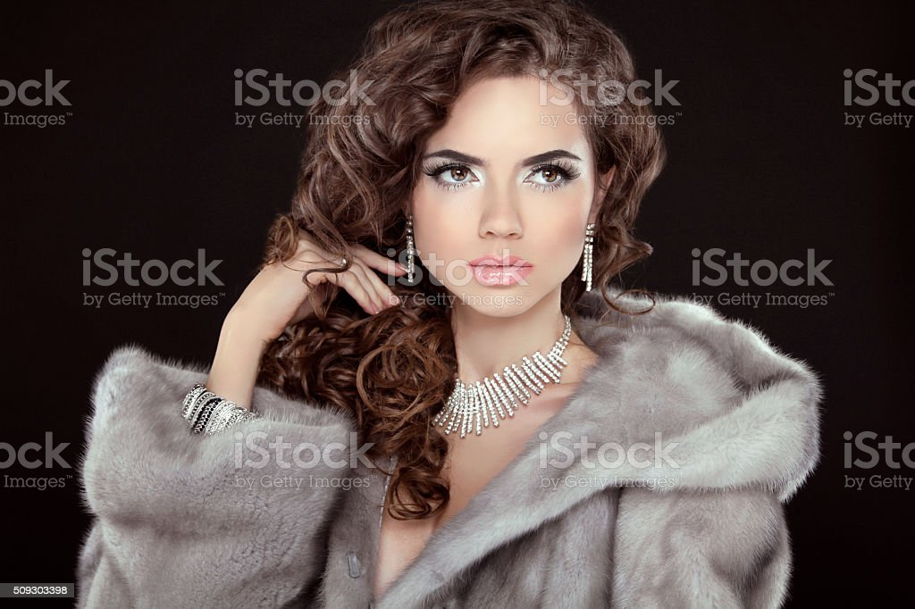 Makeup. Beautiful girl portrait. Brunette fashion woman in mink stock photo