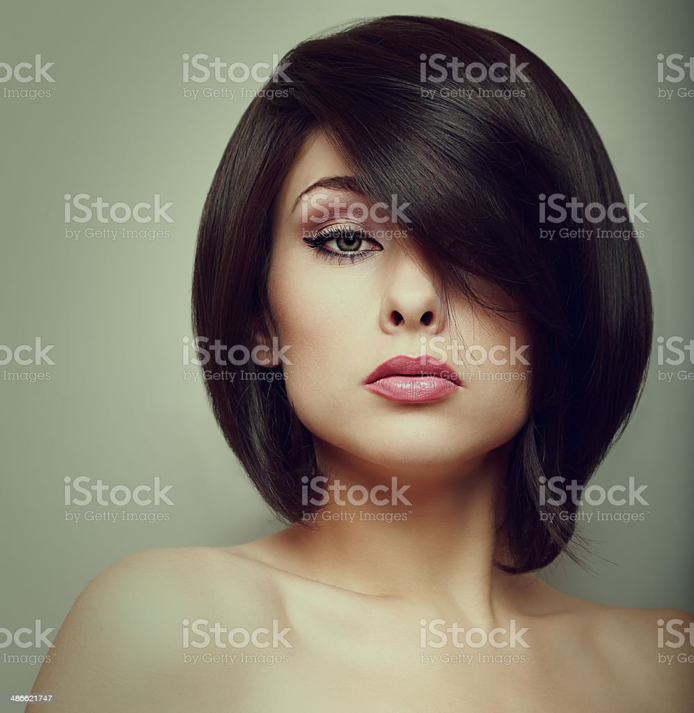 Makeup beautiful woman face with short hair style. Vintage portrait stock photo