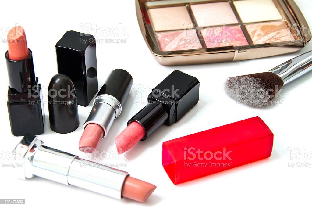 Makeup blush and lipsticks stock photo