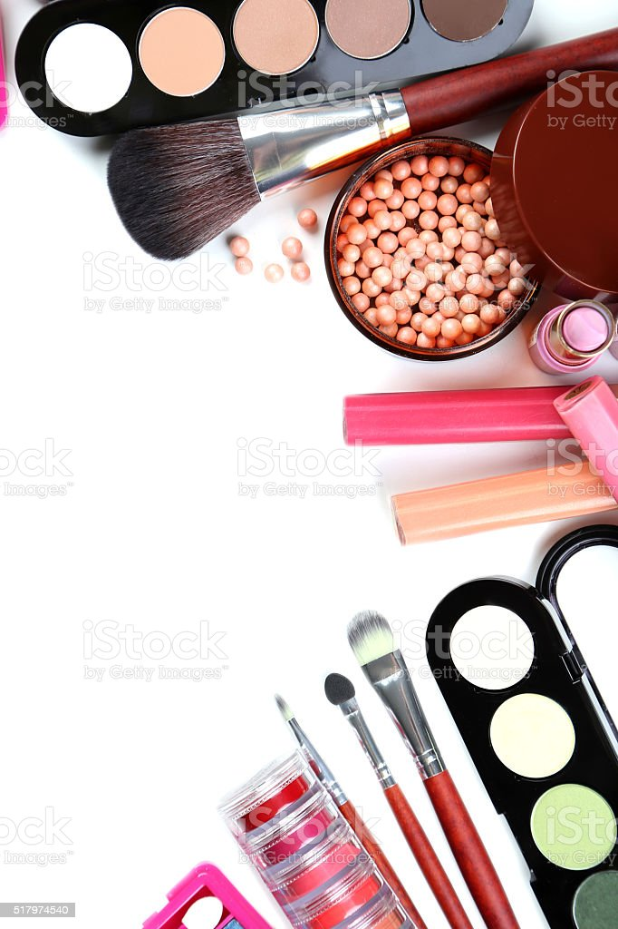 Makeup brush and cosmetics on a white background stock photo