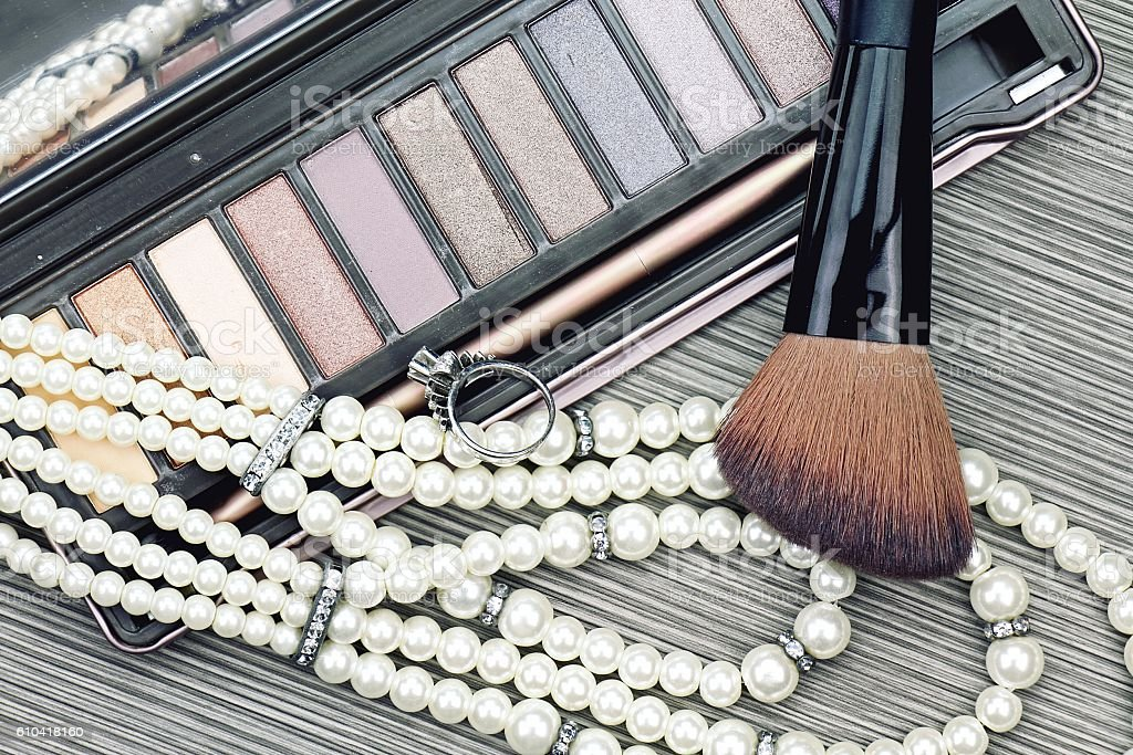 Makeup brush and eyeshadow, Set of women's accessories and cosmetics stock photo